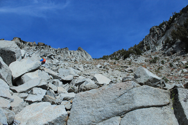 Caleb climbs above me through granite boulders high in the South Gully