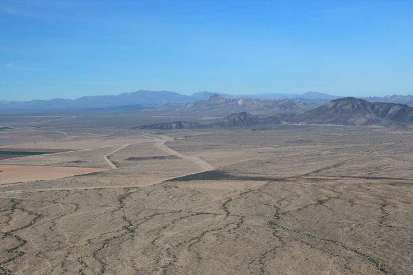 Looking northwest towards the Harquahala and Harcuvar Mountains in the distance, with Big Horn Peak and Burnt Mountain nearby