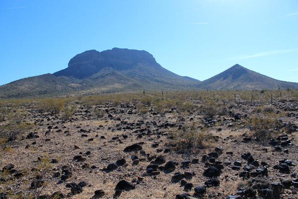 Woolsey Peak from my parking spot. Basalt rocks litter the ground.