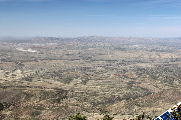 Looking west from Mount Washington. Nogales, Arizona and Sonora, lie below. The US/Mexico border wall is visible as well.