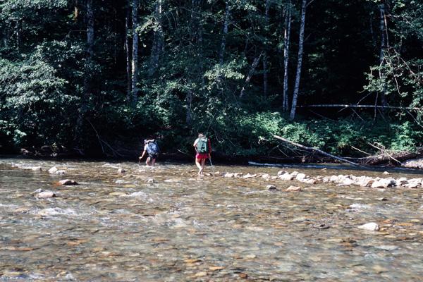 Wading across the North Fork of the Sauk River below Sloan Peak