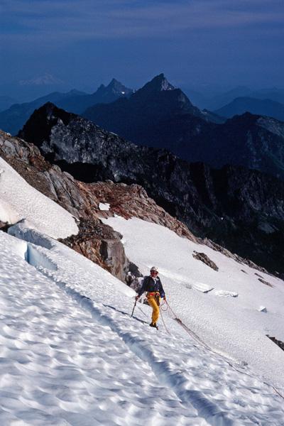 Linda climbing the glacier below the East Face of Sloan Peak