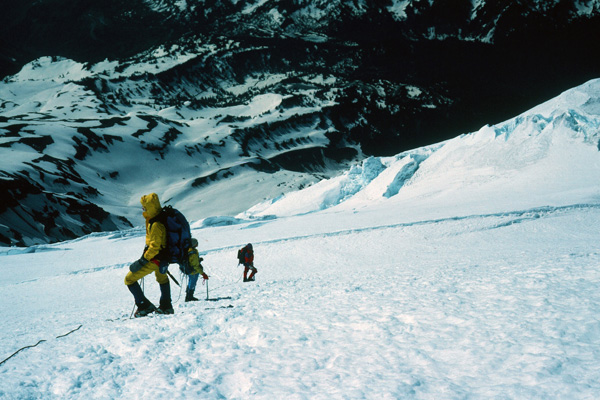 Linda, Roy, and Ray descending high on the Kautz Glacier