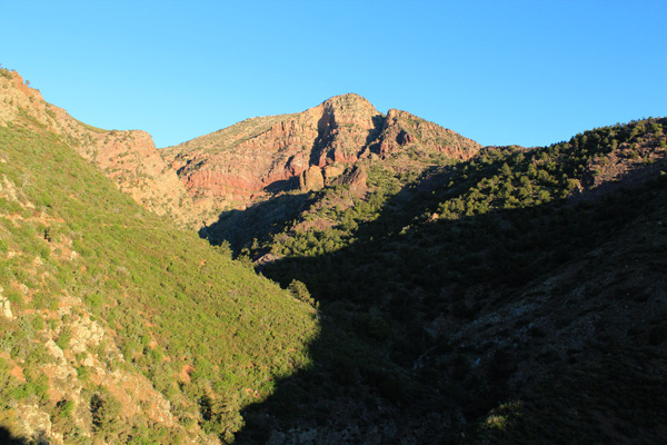 The Barnhardt Trail climbs steeply above Barnhardt Canyon to reach the north slopes of Mazatzal Peak above to the left.