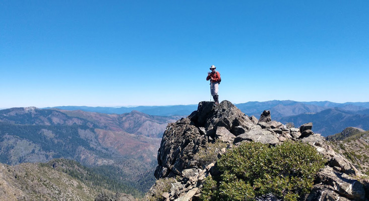 I stand on the summit of Big Craggies, surrounded by the Siskiyou Mountains (Caleb Morris photo)