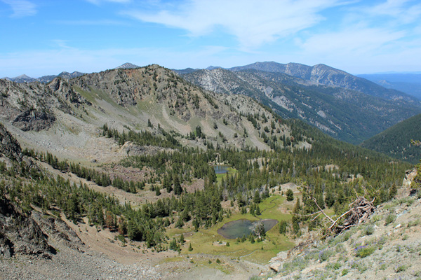 Looking into Cougar Basin and at Cougar Pond from the saddle