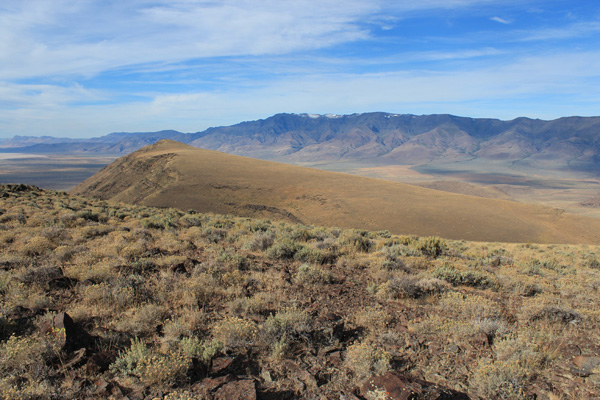 Steens Mountain rises high above to the west beyond Peak 6275, our second destination.