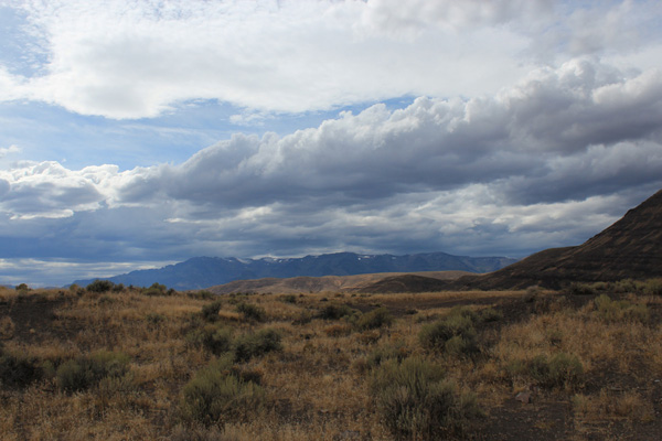 Heavy, dark clouds over Steens Mountain from Mickey Hot Springs