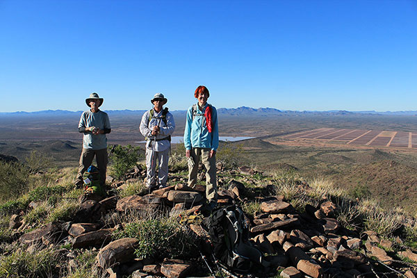 Bill, Brian, and June on Jack Benchmark SW with the Vekol Mountains and Lake Saint Clair beyond