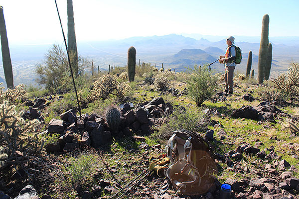 Bill on the Silver Reef Mountains Highpoint, the Tat Momoli Mountains in the distance