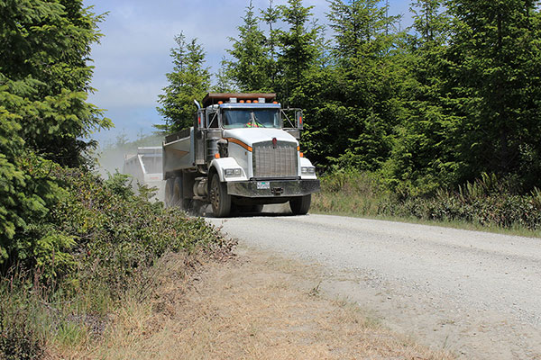 Gravel dump trucks and trailers repeatedly passed us as they carried gravel down to the road work site.