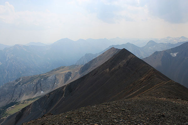 Looking south along the Hurwal Divide summit with Pete's Point left of center and Cusick Mountain beyond Hurwal Divide just right of center. It was a smoky day.