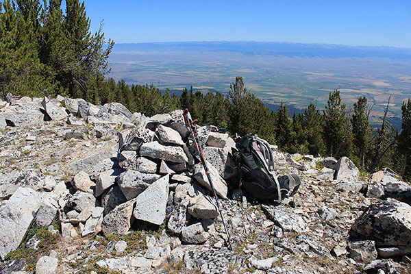The summit cairn of Peak 8566 with a registry