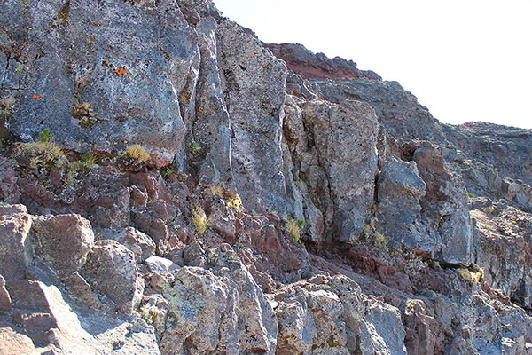 The right-side access routes up the basalt wall. I took the one in the center, Bob took the one right of it.