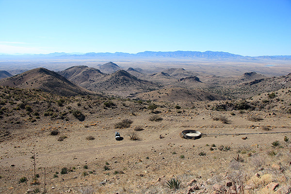 Descending towards my Jeep and the empty spring-fed water tank. The Winchester Mountains lie in the distance.