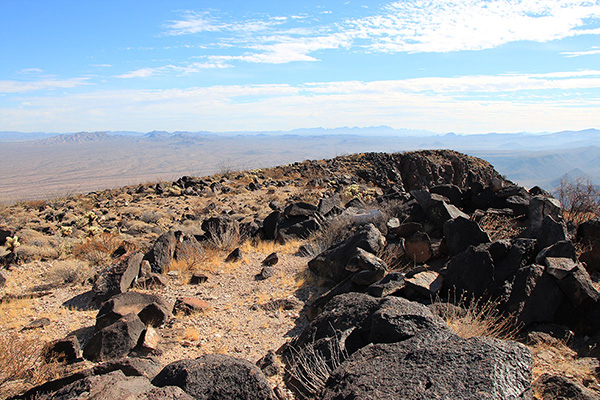 The Ajo Mountains rise on the horizon to the southeast from Growler Peak
