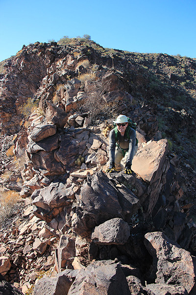 Matthias follows me down a narrow and exposed ridge high on the east ridge