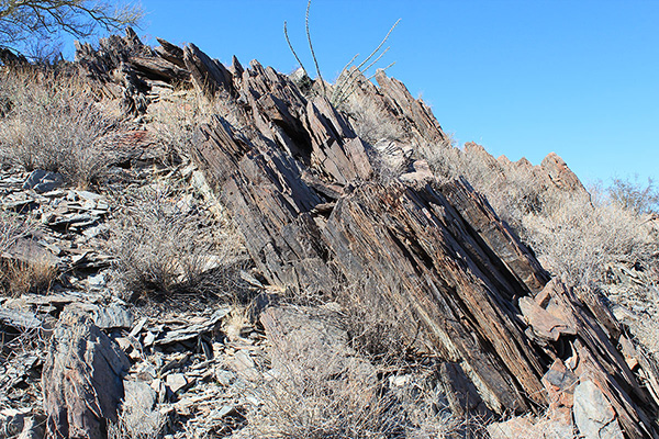 Prieta Peak is the highpoint of the Slate Mountains; I presume this is slate