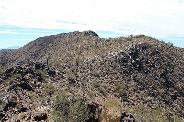 The true summit finally peeks above the ridge ahead
