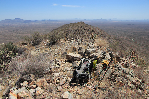 The Maricopa Peak summit rock cairn with summit registry buried within