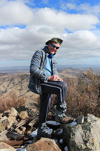 Michael writing in the Mohon Peak summit registry
