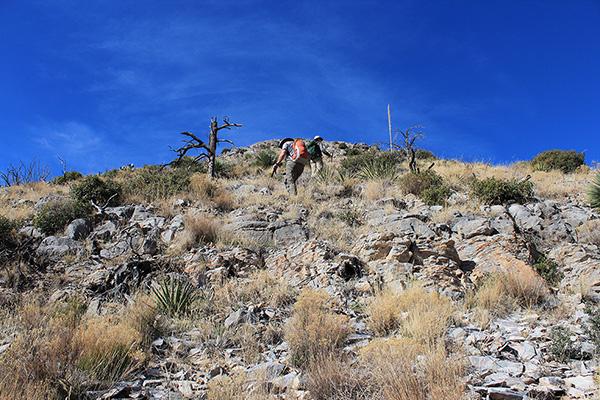 Scott and Matthias climbing up a steep slope to the ESE Ridge