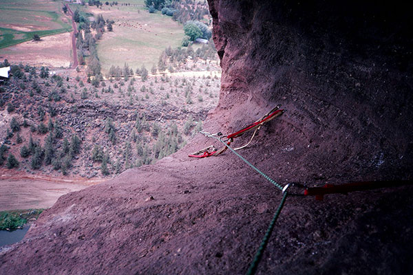 I belay Linda as she climbs the bolt ladder towards Monkey Face's mouth cave.